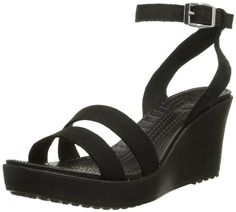 Crocs Women's Leigh Wedge Sandal -  	     	              	Price: $  54.99             	View Available Sizes & Colors (Prices May Vary)        	Buy It Now      Strap into breezy style in this sand al from Crocs. The Leigh features a summery canvas upper with an adjustable ankle strap for a secure fit. Beneath, a cushy...