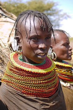 Turkana people by Rita Willaert on Flickr -  The Turkana tribe is the second largest pastoral community in Kenya. This nomadic community moved to Kenya from Karamojong in eastern Uganda and occupies the semi Desert Turkana District in the Rift valley province of Kenya. Like the Maasai and tribes, Turkana people keeps herds of cattle, goats and Camel