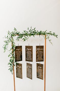 Gorgeous copper and wood table seating chart