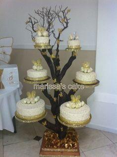 Butterflies Quinceanera cake on tree stand. Visit us http:/Facebook.com/Marissa'scake or www.elmanjarperuano.com