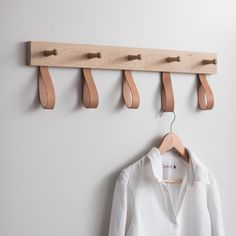 Understated and stylish, the Kelston 5 Peg Rail Coat Rack features five wooden pegs and five leather loops, making it ideal for hanging up your coats. Diy Coat Rack, Coat Hanger, Clothes Hanger, Coat Racks, Wall Coat Rack, Diy Coat Hooks, Wooden Coat Rack, Coat Pegs, Retro Furniture