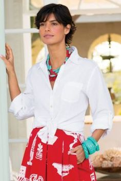 Classic white blouse with red print skirt and aqua accents.