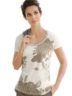 Shirt mit abstrahiertem Blumen-Druck. Kleine Borte am Halsausschnitt. Figurbetonte Form, Länge in Gr. 38 ca. 64 cm. Pflegeleichte, trageangenehme Qualität. Obermaterial: 100% Baumwolle, waschbar...