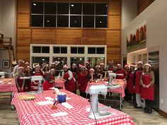 """On December 4th, Atmosphere Madison team members and A&D guests celebrated the season by giving back to those in need in our community. Frostwood Farms Kitchen provided a festive environment to get our """"Top Chef vibe"""" on by preparing lasagna for the River Food Pantry. Each of our teams prepared and layered pasta noodles, meat sauce, and ricotta with care to create 9 pans of lasagna for families in our area."""