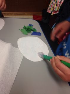 Putting glue on circles for our paper earths