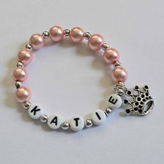 Pink Pearl and Silver Bracelet Personalized Name Bracelet with Crown Charm Child Jewelry Party Favor Infant Children Kid Adult Sizes. $4.00, via Etsy.