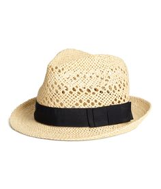 Stay sun-safe in this chic straw hat with black ribbon band. | H&M Swim