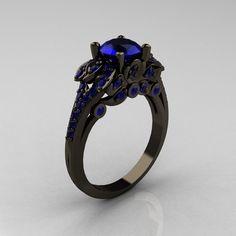 Classic 14K Black Gold 1.0 CT Blue Sapphire Blazer Wedding Ring R203-14KBGBS. $2,499.00, via Etsy.