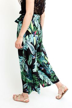 These black trousers give summertime style a glamorous update. The tropical print is shown in yellow, blue and green hues, while the high-rise waist ensures a flattering silhouette. Wear yours with a simple silk top for guaranteed sophistication. From Sienna With Love.      Available at Sienna Boutique.