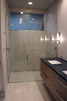 Gorgeous Tiled Bathroom Floor And Curbless Shower Featuring Asian Statuary Marble Accent Panel W Custom Made Gl The Portfolio Of Exact Tile Inc