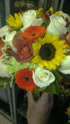 Here's a perfectly colorful bouquet for your wedding! Sunflowers roses gerbera daisies and more! americasflorist.com