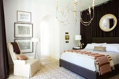 jean+allsopp+cococozy+bedroom+black+drapery+curtain+behind+bed+french+chandelier+arched+doorway+moroccan+pattern+rug+grey+white+white+walls....