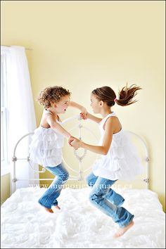 two little monkeys jumping on the bed...catch the kids/grandkids doing a no-no