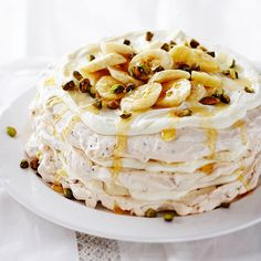 We've taken classic pavlova, the meringue dessert with a crisp crust and fluffy inside, and layered it with piles of bananas, pistachio nuts, and gooey whipped cream cheese: http://www.bhg.com/recipes/desserts/fruit/banana-desserts/?socsrc=bhgpin022814bananacreampavlovatower&page=8