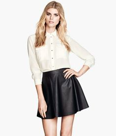 love the faux leather skirt. Wear it high waisted with blouse. Find @ H for $24.95