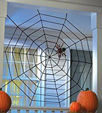 Cute, right?  To put it in perspective … here it is in the room.     Rather large. Rather impressive. Rather cheap. $1 for the yarn at the Dollar Store, $1 for the two way tape.  If you need to go out and buy the spiders, that'll set you back … Continue reading →