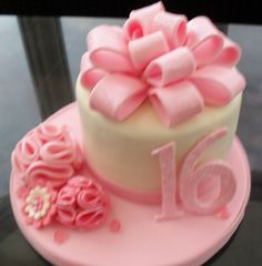 Sweet 16 Cake-Vanilla Cake... dont like the flower on the side.... and some chocolate brown sparkles or jewels?