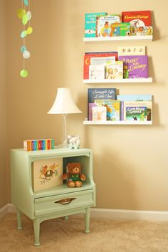 "Love the neutral walls + colorful accents like the books (From ""project nursery"" blog)"