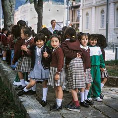 Colombia 2001. A teacher gathers her schoolgirls in Parque de Usaquén, Bogotá