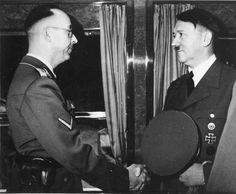 Rare Himmler-Hitler photo taken on Hitler's special train on April 20, 1941, Hitler's 52nd birthday. Check out Himmler's holster!