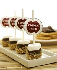 S'mores pops - what a great treat for sitting around the fire on a crisp autumn night while telling ghost stories...
