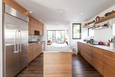 """Elisabeth Prueitt and Chad Robertson of famed San Francisco bakery Tartine moved into a house with a preexisting kitchen, but they did kit it out their own way, using the island as a """"pass"""" (à la commercial kitchens) and the warming drawer for storage."""