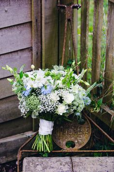 Summer, country bridal bouquet, whites and cornflower blue. Photography by Mitzi de Margary, www.margaryweddings.com.
