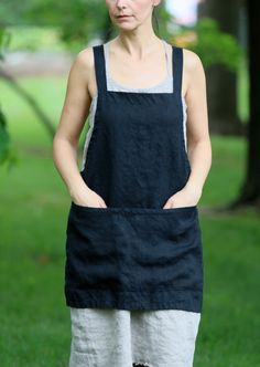 This is a shorter and lighter version of our linen Square-Cross apron. Easy to put on apron that slips over your head with no sashes to tie. Made of medium weight linen with a large front pocket. Accommodates most sizes and allows for easy movement. For the kitchen, garden, craft room or
