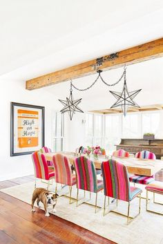 Starburst light fixtures and brightly striped dining room chairs