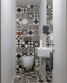 The small powder room features graphic ceramic tile from Couleurs & Matures Patc. - The small powder room features graphic ceramic tile from Couleurs & Matures Patchwork. A Parisian Pied-À-Terre by Piret Johanson Studio Small Bathroom Wallpaper, Bathroom Design Small, Bathroom Interior Design, Small Toilet Design, Bad Inspiration, Bathroom Inspiration, Bathroom Ideas, Wc Bathroom, Bathroom Flooring