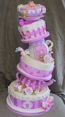 pink and white baby shower tower wedding cake, six tiers, teapots, cups and saucers, flowers