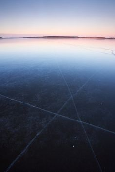 Photo: Cracks in ice surface of frozen lake January