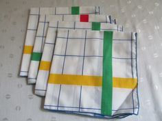 """Brand New Cotton White Napkins with bold and bright Yellow, Blue, Green and Red stripes! Very nicely done rolled stitched hems. No tags so do not know the manufacturer. Measure 16 1/2"""" by 17 1/2"""". Should be washed before use as these have not been used yet. Lovely napkins for anytime!!"""