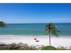 The beach in Naples, Florida - Gulf of Mexico - Red Umbrella