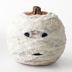 Mummify Your Pumpkin  Turn your pumpkin into a mysterious mummy for Halloween by wrapping it in self-stick gauze.