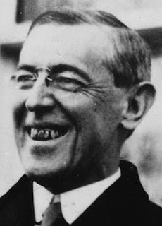 """Woodrow Wilson was president of the United States from 1913 to 1921. He kept America out of WWI until 1917, one year before it ended. He was a Democrat but was, """"deeply racist in his thoughts and politics."""" """"His administration racially segregated federal employees and the Navy."""" (Kim & Hana)"""