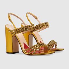 cce115744 Metallic leather sandal with crystals. gucci.com