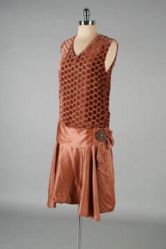 Dress: ca. 1920's, silk velvet and silk satin, silk crepe lining, polka dot print bodice, beaded medallion accent at left hip.
