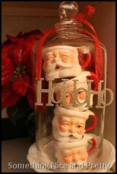 love the santa mugs stacked in a cloche!