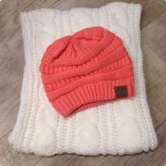 Slouchy Knit Beanie -CORAL Keep warm while looking ADORABLE! Super cute beanie with C.C label on it. Adorable, slouchy, thick knit and super soft.  This listing is for the CORAL beanie. Price is firm. Bundles of 2 or more save 15%. Lots of colors available. Check other listings❄️ Accessories Hats
