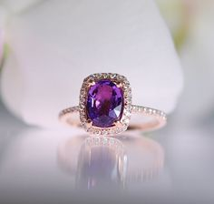 Engagement ring by Eidelprecious. Rose gold engagement ring with Peach sapphire.This ring features a 1.35ct cushion sapphire, amazing lavender
