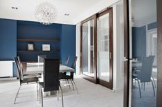 Perhaps we could do an accent wall with a cool color, like Prussian Blue.
