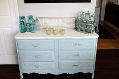 (I LOVE IT!)  Color - annie sloan chalk paint in old white for the top and duck egg mixed with the old white and louis blue for the base.  ~Cameras and Chaos~