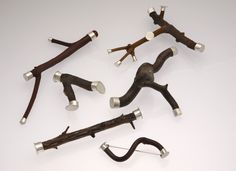Kathleen Faulkner...  pins  Various woods and sterling silver in various sizes