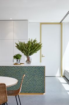 Love this kitchen! green mini subway tiles and gold and wood accents