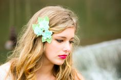 Mint green flower hair accessory for a bridesmaid or bride.