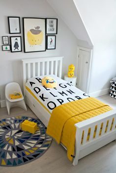A boy's bedroom with pops of yellow.