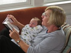 Sweet picture. It's never too early to start reading to a child.