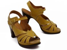 Chie Mihara Yoisho, $368. Mustard yellow is my new favorite color.