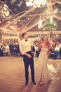 love the see through tent with the branch stuff above the dance floor